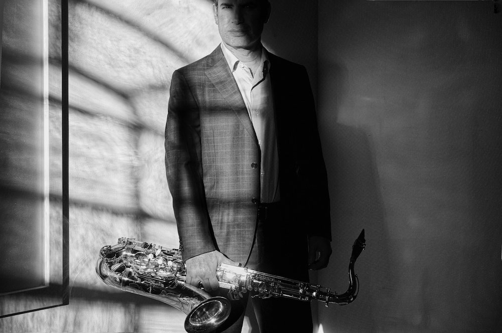 Matthew Levy standing with saxophone
