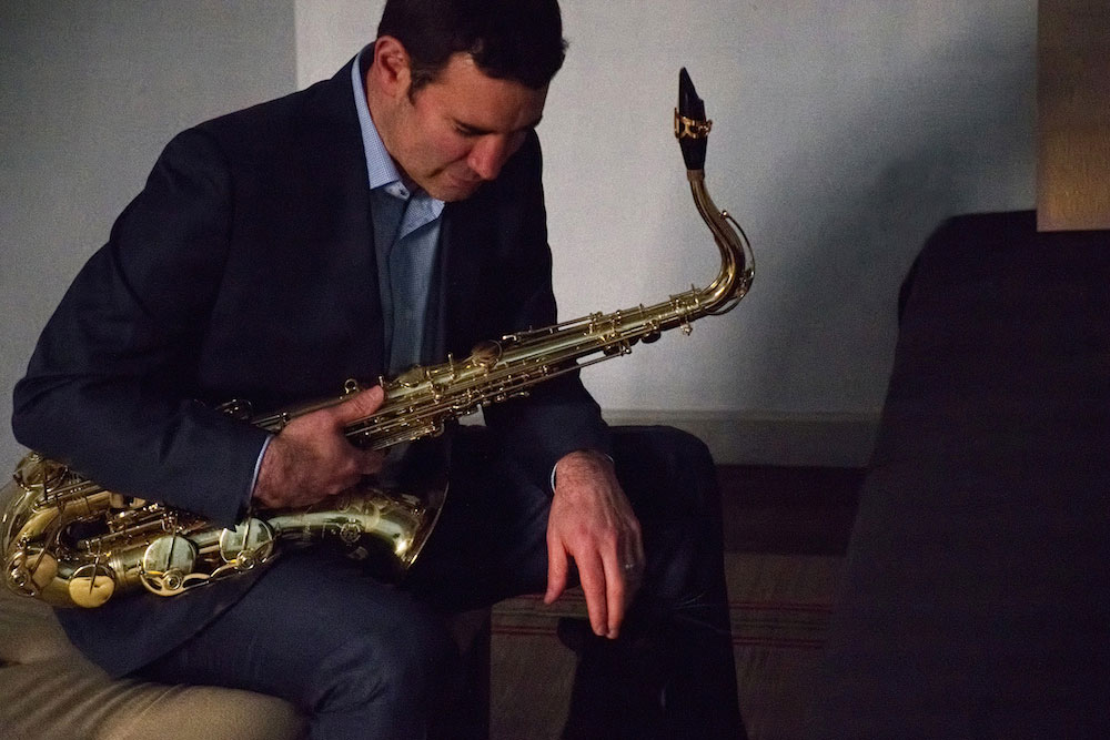 Matthew Levy seated with saxophone